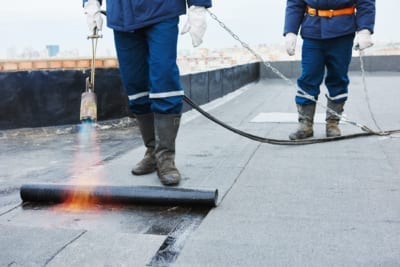 workers on a flat roof