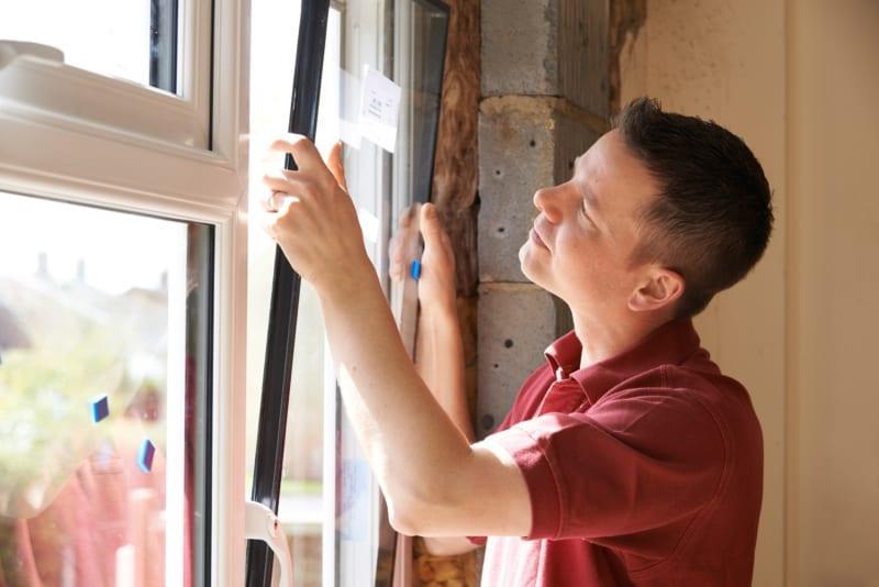 man installing new windows