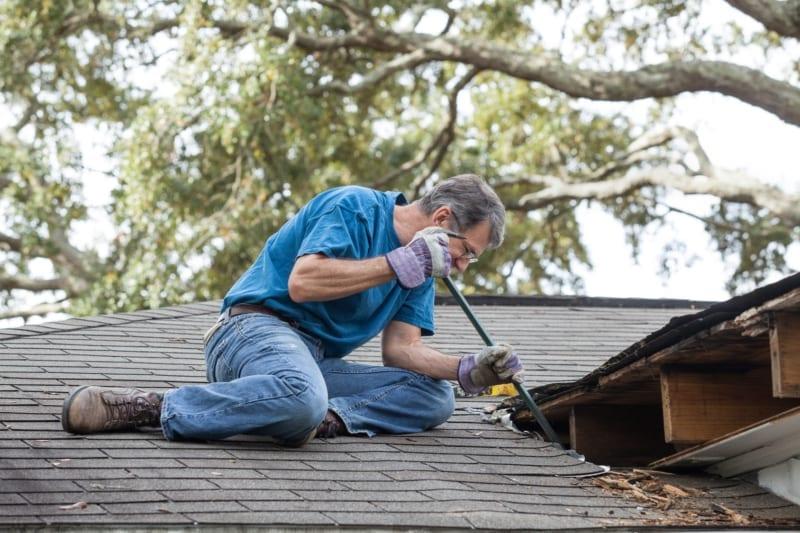 Man Repairing Leaking Roof
