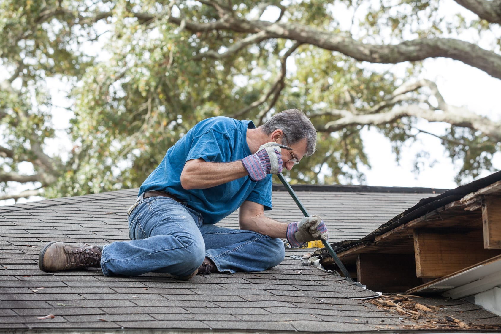Man Repairing Leaking Roof