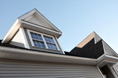 Close up view of a newly built house rooftop and siding