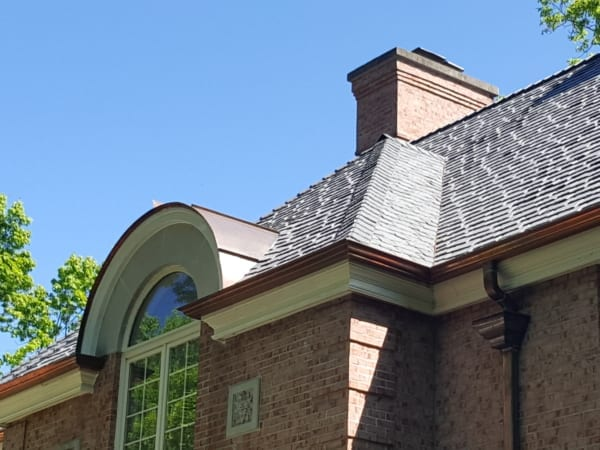 Restored Curved Dormer Roof by Community Roofing & Restoration