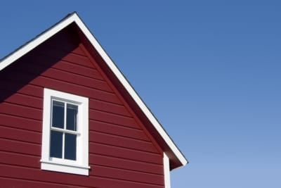 house with red siding and white trim