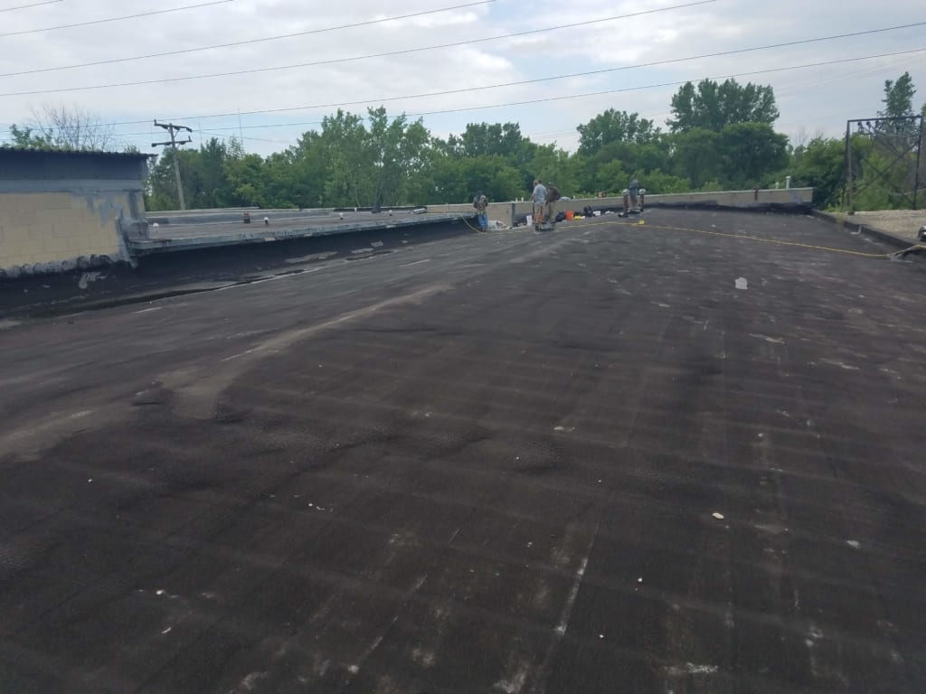 Milwaukee County Commercial Flat Roof Repaired by Community Roofing